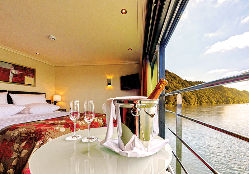 Vacationsmag_river-cruising-ArtistryII_Panorama-Suite_champagne