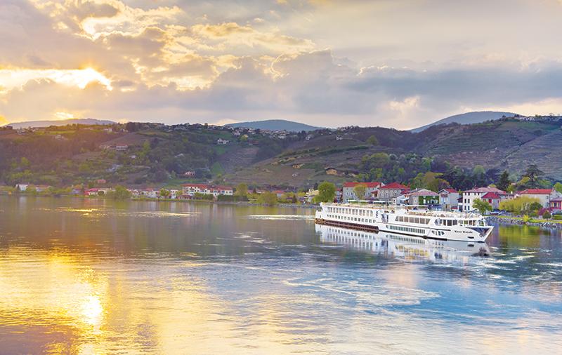 Vacationsmag_river-cruising-uniworld-River-Royale-exterior-at-dusk