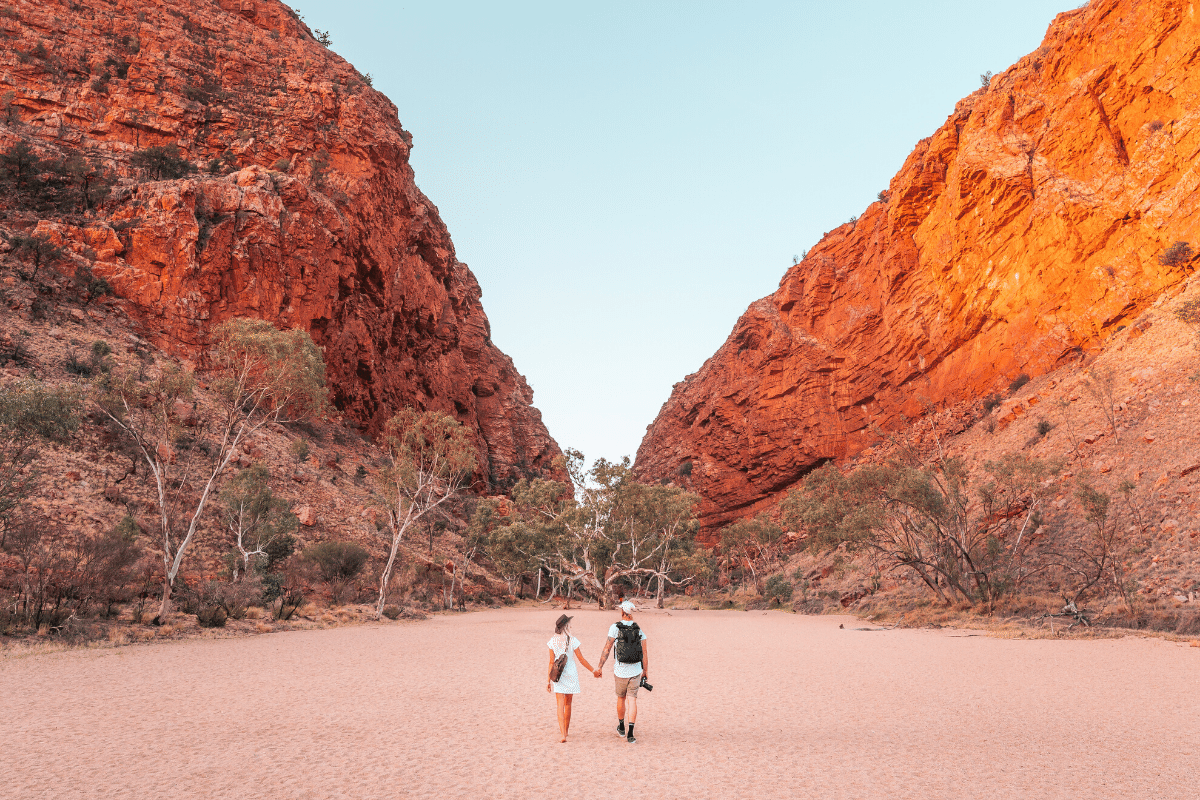 Northern Territory top sites: Couple walking towards Simpsons Gap. | Image: Tourism NT/Jesse Lindemann