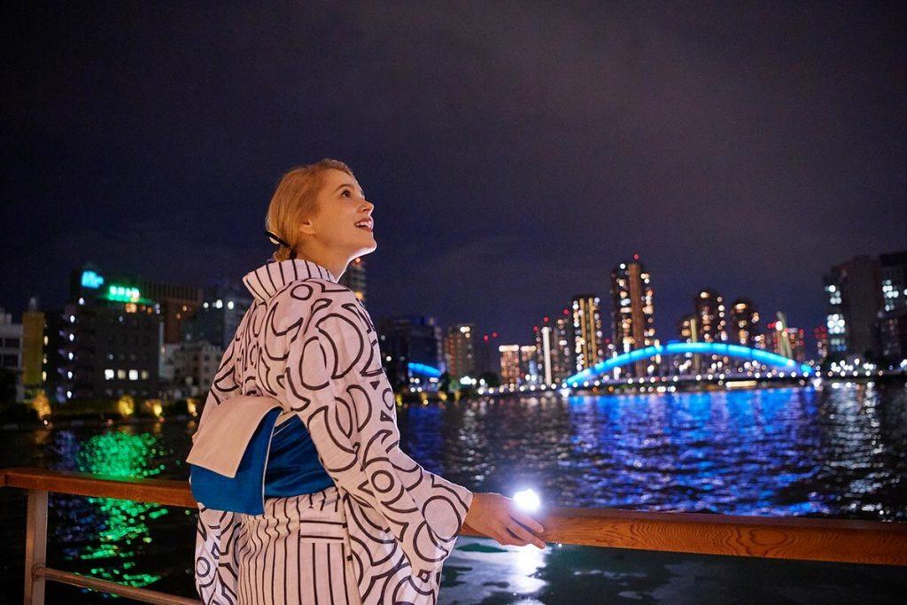 Tourist enjoying Tokyo nightlife