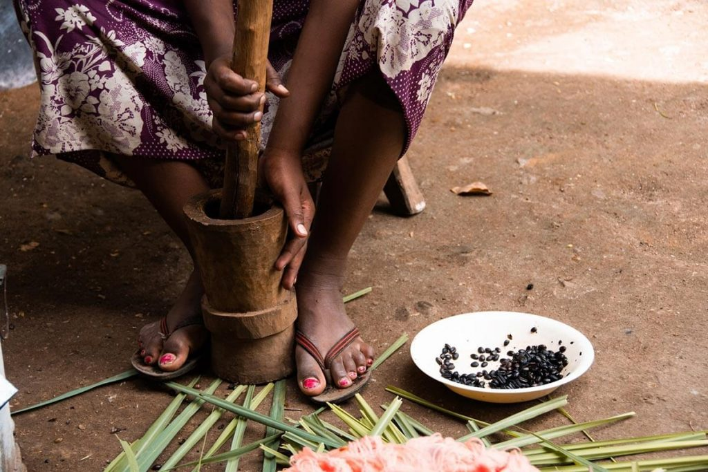 A girl grinds coffee beans during a traditional Ethiopian coffee ceremony