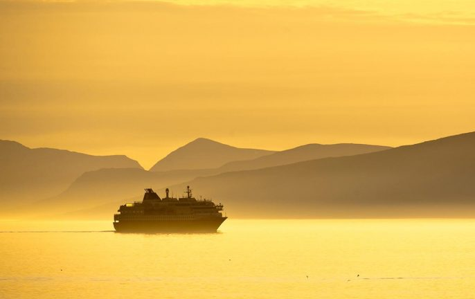Hurtigruten cruising through the Midnight Sun