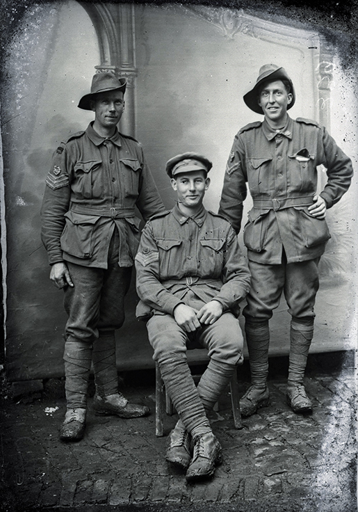 Group portrait of three members of the 8th Machine Gun Company. Identified centre is 101 Sergeant Sydney William Phefley.